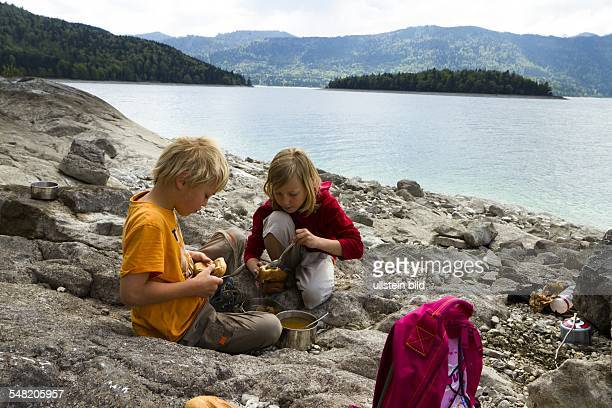 Germany Bavaria Children playing at the lake 'Walschensee'