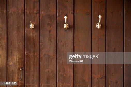 Germany, Bavaria, Coat hooks on wood wall