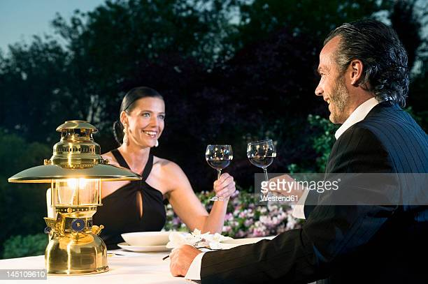 Germany, Bavaria, Couple having candlelight dinner
