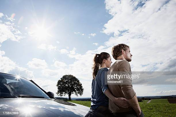 Germany, Bavaria, Couple standing by car