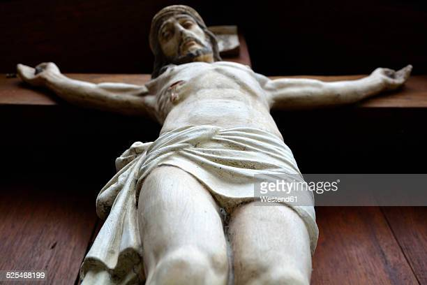 Germany, Bavaria, Dornach, sculpture of crucified Jesus Christ, view from below