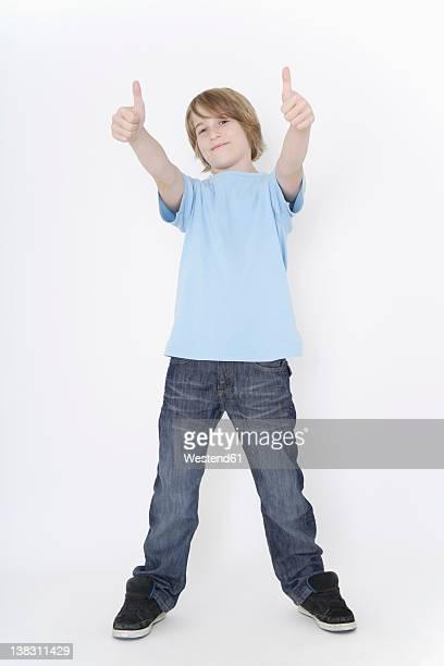 Germany, Bavaria, Ebenhausen, Boy standing against white background, smiling