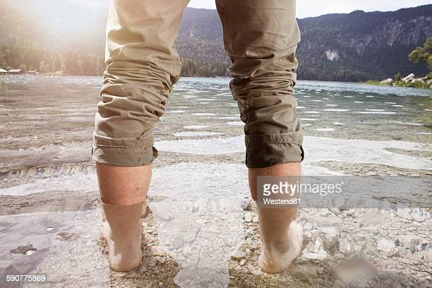 Germany, Bavaria, Eibsee, man standing in lake