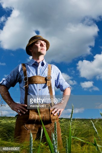 Germany, Bavaria, Farmer standing in field and looking away