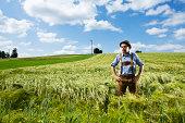 Germany, Bavaria, Farmer standing in field