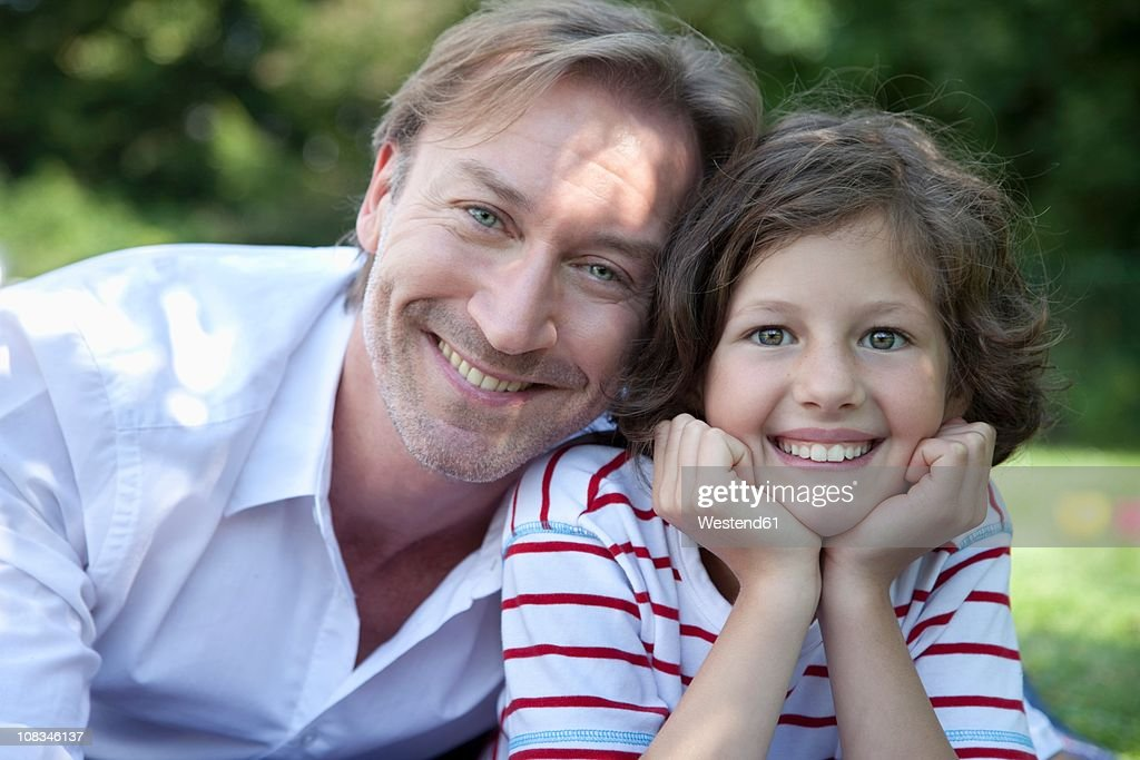 Germany, Bavaria, Father and daughter (8-9 Years) having fun at picnic, smiling, portrait : Stock Photo