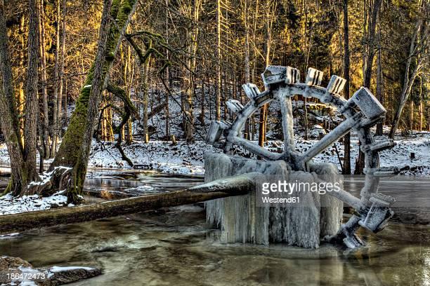 Germany, Bavaria, Frosted water wheel at river Waldnaab
