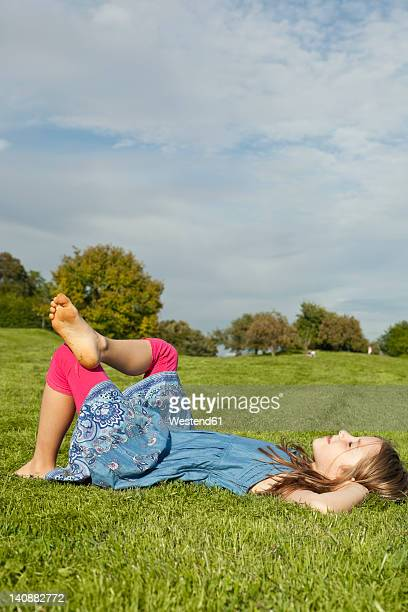 Germany, Bavaria, Girl relaxing in park