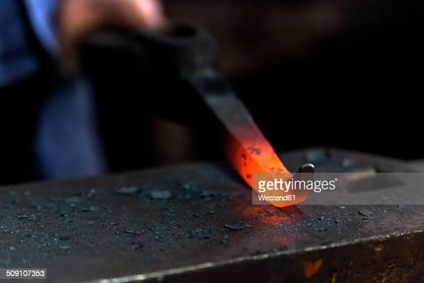 Germany, Bavaria, Josefsthal, glowing pickaroon at historic blacksmith's shop