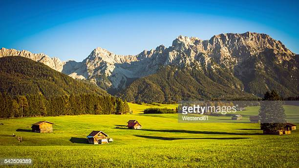 Germany, Bavaria, Krun, Barn in meadow, Karwendel mountains in background