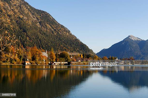 Germany, Bavaria, Lake Walchensee and Walchensee village with Jochberg mountain in background
