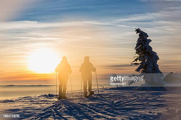 Germany, Bavaria, Mature man and woman hiking on Grosser Arber