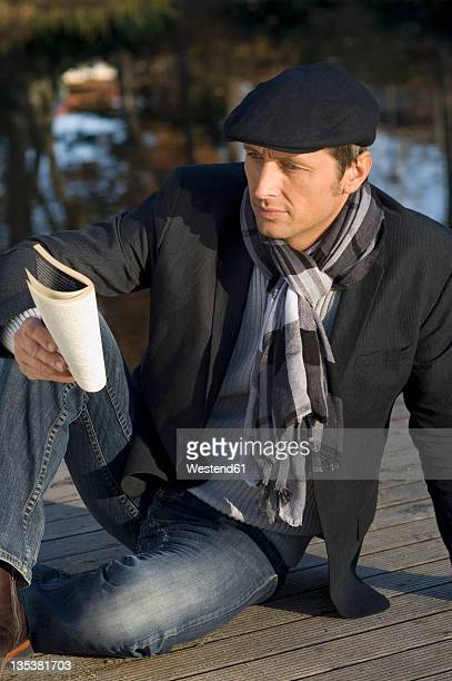 Germany, Bavaria, Mature man reading book
