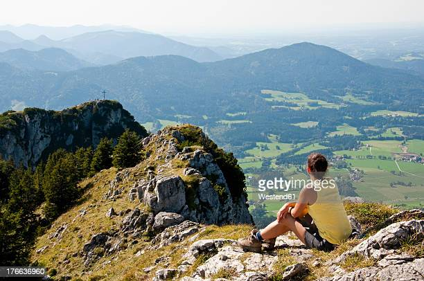 Germany, Bavaria, Mid adult woman looking from Breitensein to bavarian alps
