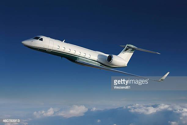 Germany, Bavaria, Munich, Businessjet flying in blue sky