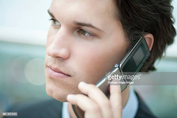 Germany, Bavaria, Munich, Businessman using mobile phone, close-up