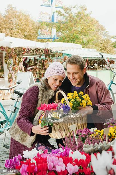 Germany, Bavaria, Munich, Couple at Viktualienmarkt selecting flowers