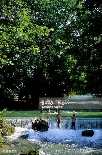 Germany Bavaria Munich English Garden Isar River People Swimming