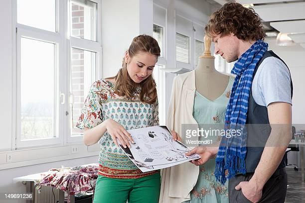 Germany, Bavaria, Munich, Fashion designers in discussion