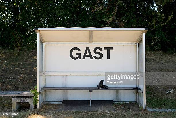 Germany, Bavaria, Munich, football shoes lying  on coaching bench