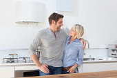 Germany, Bavaria, Munich, Mature couple in kitchen, smiling