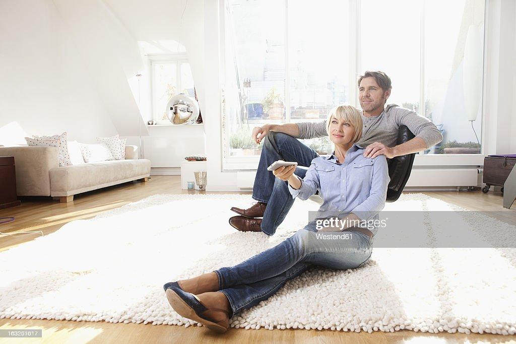 Germany, Bavaria, Munich, Mature couple watching tv