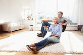 Germany, Bavaria, Munich, Mature couple watching tv