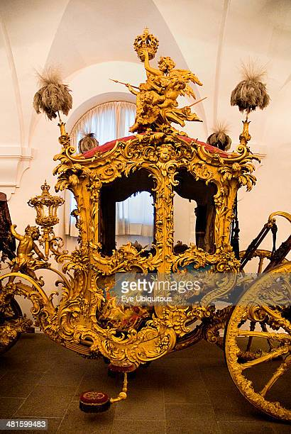 Germany Bavaria Munich Nymphenburg Palace Marstall Museum Highly ornate gold and painted coach made for the coronation of King Max I Joseph in 1818
