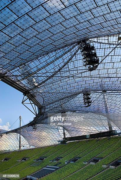 Germany Bavaria Munich Olympic Stadium built as the main venue for the 1972 Summer Olympics View along seating beneath large sweeping canopies of...