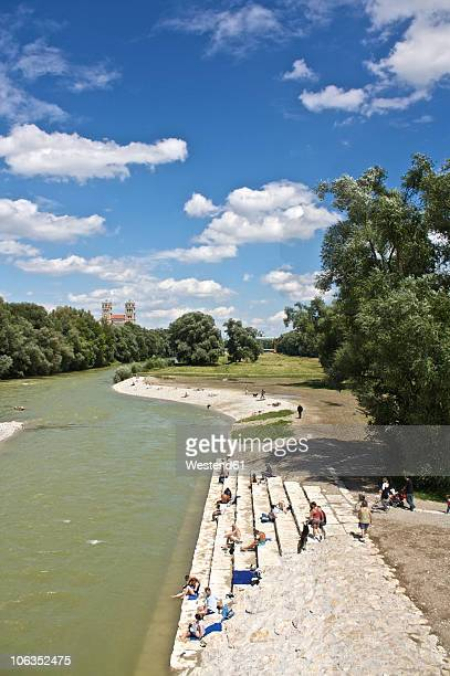Germany, Bavaria, Munich, People at river isar with st. maximilian church in background