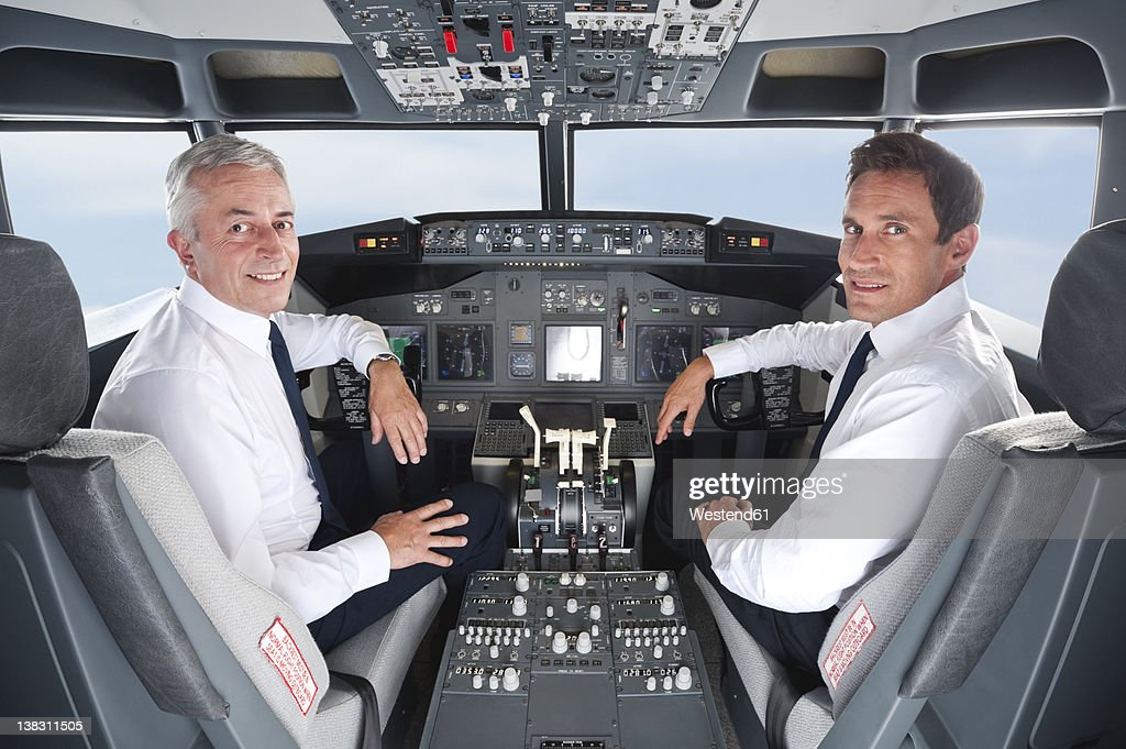 Germany, Bavaria, Munich, Pilot and co-pilot piloting aeroplane from airplane cockpit