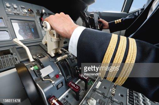 Germany, Bavaria, Munich, Pilot piloting aeroplane from airplane cockpit
