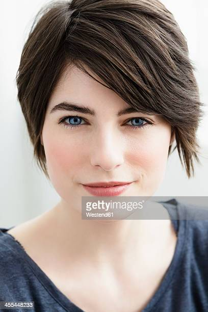 Germany, Bavaria, Munich, Portrait of young woman, smiling