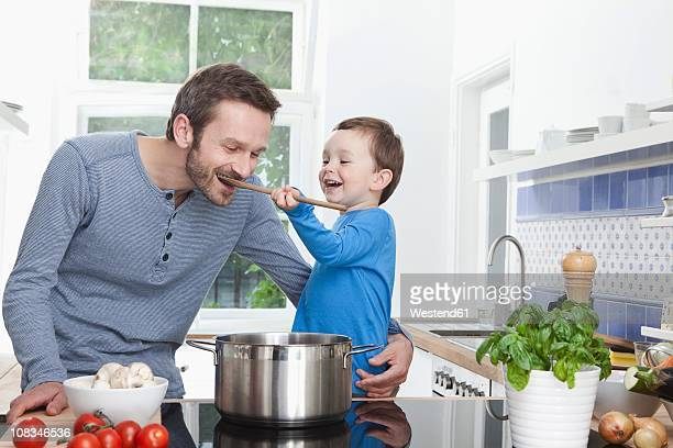 Germany, Bavaria, Munich, Son (2-3 Years) feeding meal to father