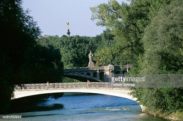 Germany, Bavaria, Munich, The river Isar at the Praterinsel, Friedensengel in the background