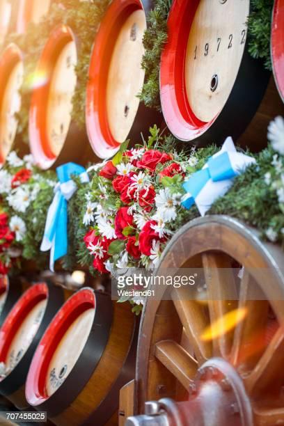 Germany, Bavaria, Munich, wooden barrels on cart at Oktoberfest