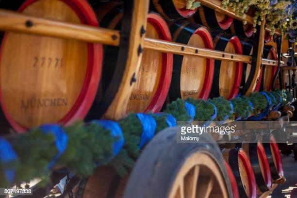 Germany, Bavaria, Munich, wooden beer kegs on cart at Oktoberfest
