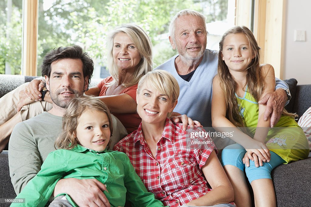 Germany, Bavaria, Numerberg, Portrait of family in living room : Stock Photo
