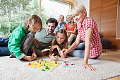 Germany, Bavaria, Nuremberg, Family playing board game together