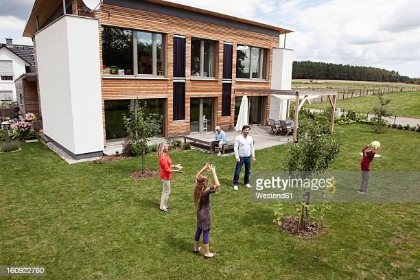 Germany, Bavaria, Nuremberg, Family playing in garden