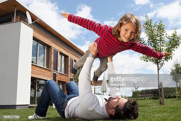 Germany, Bavaria, Nuremberg, Father balancing his son