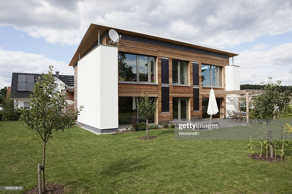 Germany Bavaria Nuremberg View Of Modern House With Garden Stock