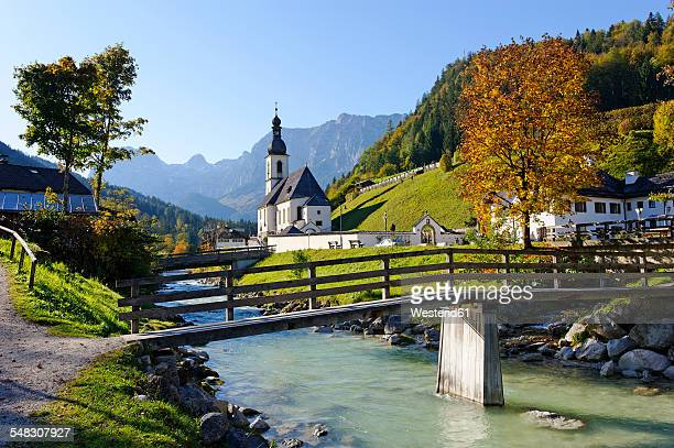 Germany, Bavaria, Parish church St Sebastian in front of Reiteralpe mountain
