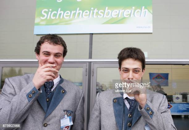 Germany Bavaria Passau political ash wednesday participiants smoking outside
