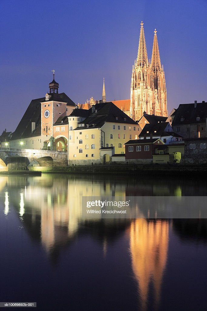 Germany, Bavaria, Regensburg, Cathedral and old town gate and Danube river at night
