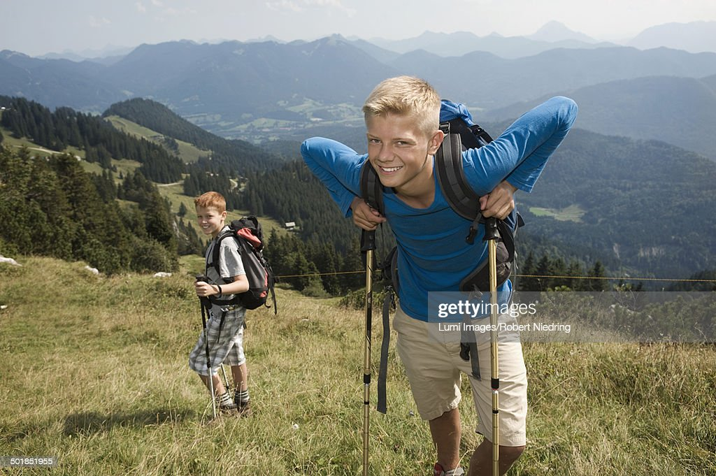 Germany, Bavaria, Two boys hiking in mountains : ストックフォト