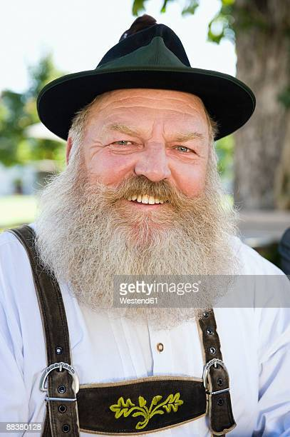 Germany, Bavaria, Upper Bavaria, bavarian man wearing traditional costume, smiling, portrait, close-up