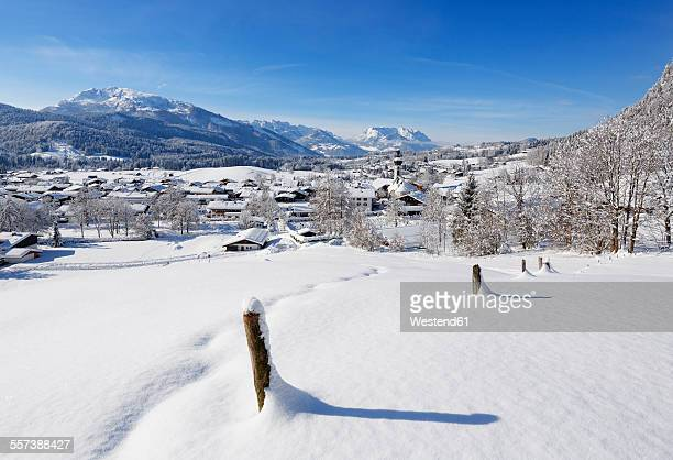 Germany, Bavaria, Upper Bavaria, Chiemgau, View to Reit im Winkl in winter, Unterberghorn and Kaiser mountains in the background