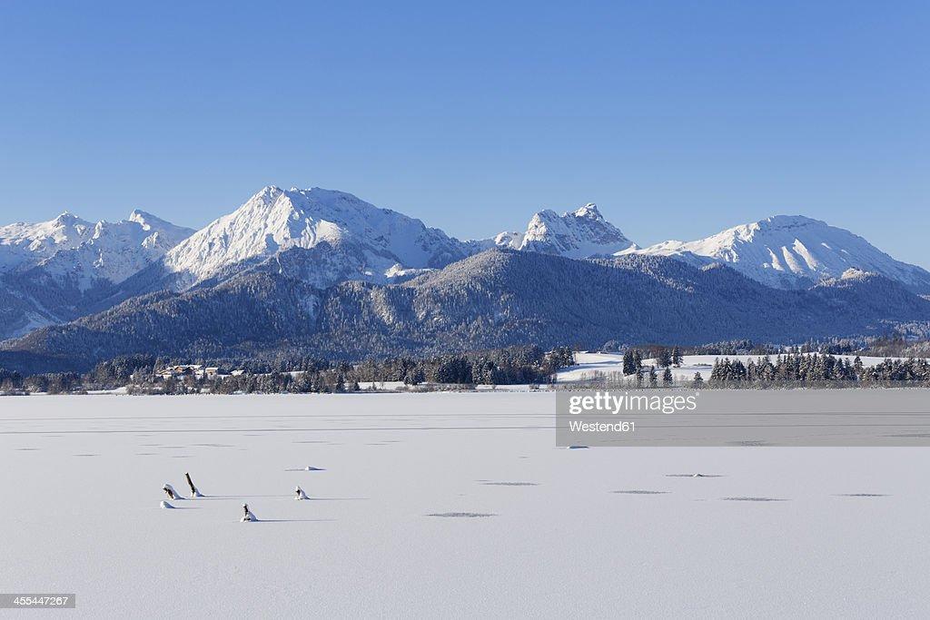 Germany, Bavaria, View of Hopfensee Lake and Tannheim mountains