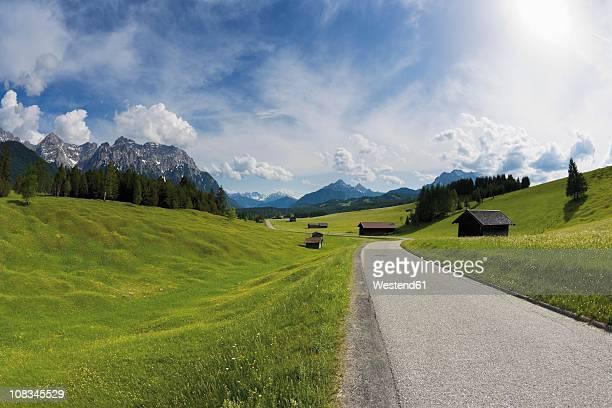 Germany, Bavaria, View of road through rural landscape near Karwendel mountains